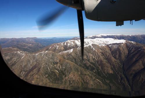 Snow-topped Coastal Mountains to the right