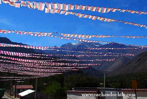 Chilean Flag banners in Andean Town © M Snook